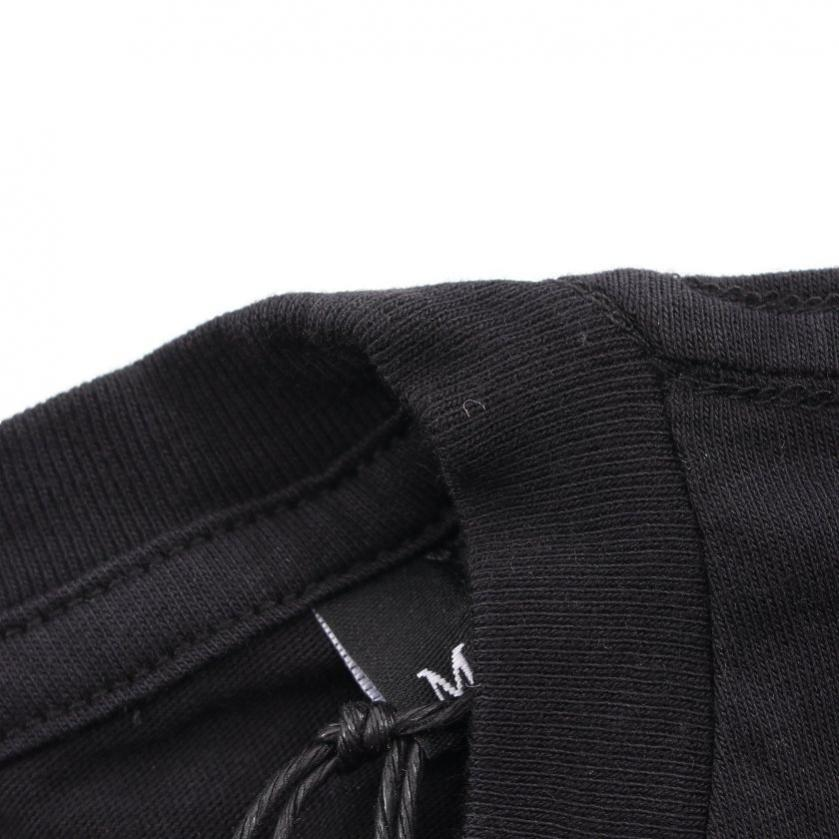 DIESEL・トップス・Tシャツ カットソー 黒 白 黄色 ロゴプリント バックプリント