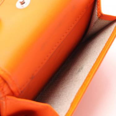 JIMMY CHOO・財布・小物・NEMO ネモ 三つ折り財布 レザー オレンジ スタースタッズ ラインストーン